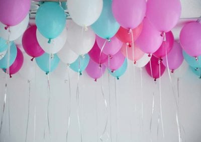 Colorful balloons in room prepared for birthday party